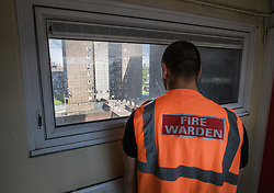 © Licensed to London News Pictures. 11/08/2017. London, UK. A fire warden checks the 4th floor of a tower block on the Ledbury Estate. Fire wardens have been in place on every other floor here on a 24 hour watch since the Grenfell fire tragedy in June. Residents on the Ledbury Estate in south London have been told they will have to leave their properties over the next few weeks. A structural survey carried out after the Grenfell fire found cracks that could lead to a collapse if a gas explosion occured in one of the flats. Photo credit: Peter Macdiarmid/LNP