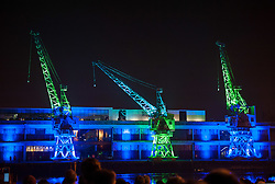 © Licensed to London News Pictures. 03/10/2015. Bristol, UK.  Crane Dance Bristol. Three of Bristol's iconic 1950s electric cranes outside M Shed perform in a one-off spectacular performance by Pervasive Media Studio resident Laura Kriefman.  Photo credit : Simon Chapman/LNP