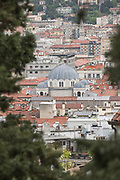 Aerial view of rooftops of Trieste with dome of Serbian Orthodox Saint Spyridon church, Trieste, Italy