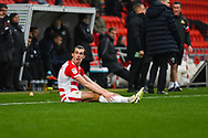 John Marquis of Doncaster Rovers (9) sits on the floor after been fouled off the ball during the EFL Sky Bet League 1 match between Doncaster Rovers and Scunthorpe United at the Keepmoat Stadium, Doncaster, England on 15 December 2018.