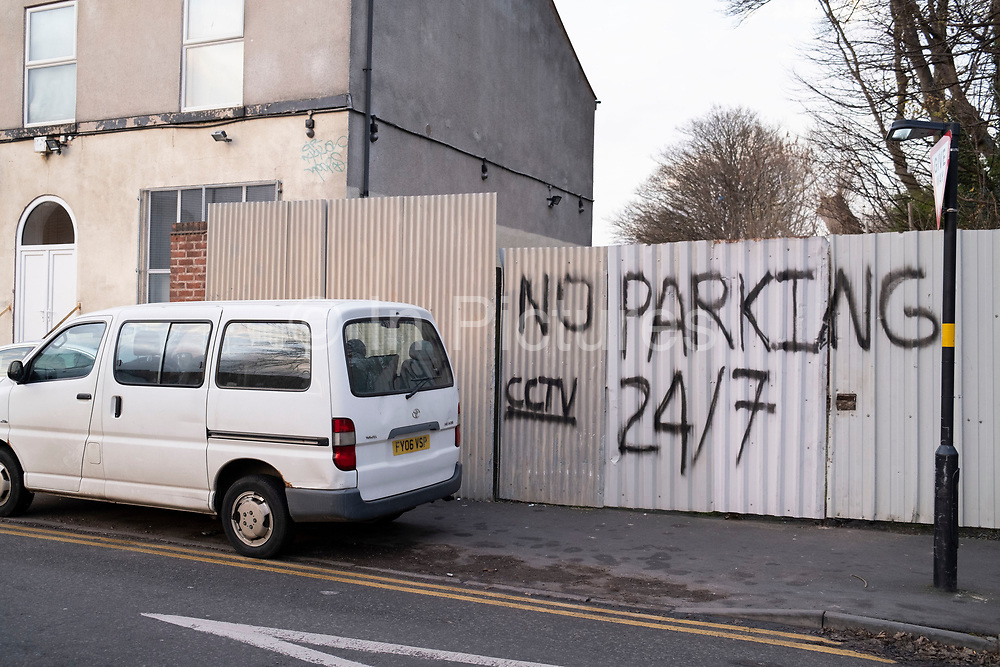 No parking sign painted on a wall to prevent pavement parking in Balsall Heath on 24th November 2020 in Birmingham, United Kingdom. Birmingham has become a city where locals say that a certain ireesponsibility has developed, where drivers show little respect for the law, and seem to want to park anywhere they choose.