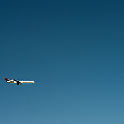 A Delta Connect passenger jet against a clear blue sky.