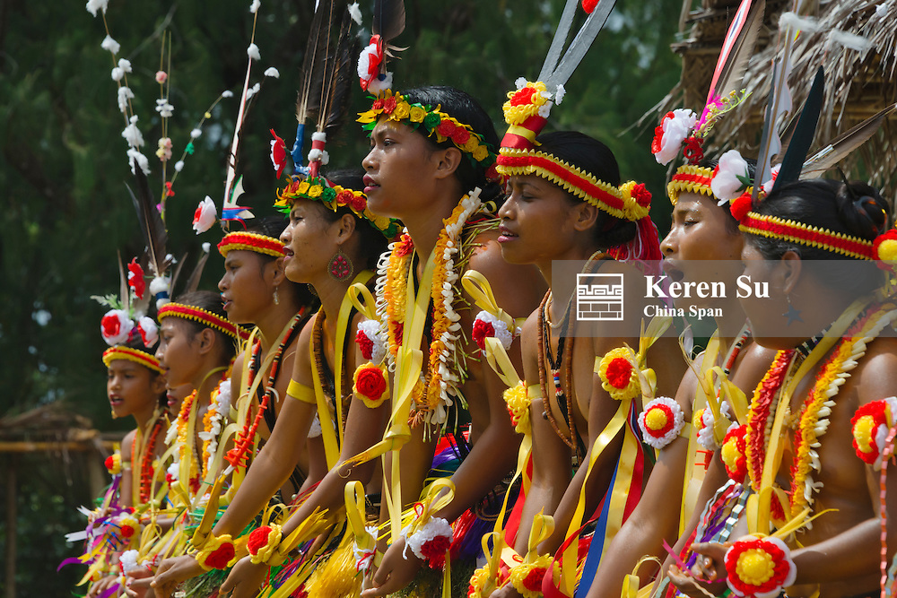 Yapese girls in traditional clothing dancing at Yap Day Festival, Yap Island, Federated States of Micronesia