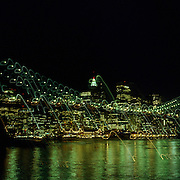 A Panoramic view of Downtown Manhattan at night showing the Brooklyn Bridge in New York, USA  on May 23, 2007 in New York, USA.  Photo Tim Clayton