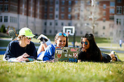 UK freshman Katelyn Zinsmeiste, Maddie Gitschier, center and Vanessa  DeAnda, right, enjoyed  sunny  70 degree temperatures after classes on Tuesday March 8, 2016 in Lexington, Ky.