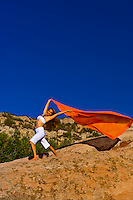 Woman doing yoga, South Valley Park, Littleton, Colorado USA