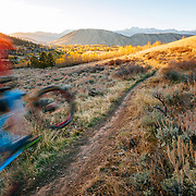 Andrew Whiteford gets a little air during autumn sunset above the town of Jackson, Wyoming.