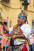 A Voladores de Papantla, the Papantla Flyers, perform their ancient Mesoamerican ceremony in the Jardin Allende during the week long fiesta of the patron saint Saint Michael in San Miguel de Allende, Mexico.