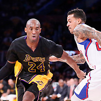 31 October 2014: Los Angeles Lakers guard Kobe Bryant (24) drives past Los Angeles Clippers forward Matt Barnes (22) during the Los Angeles Clippers 118-111 victory over the Los Angeles Lakers, at the Staples Center, Los Angeles, California, USA.