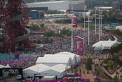 © Licensed to London News Pictures. 12/08/2012. LONDON, UK. Thousands of people are seen in the Olympic Park ahead of the the closing ceremony of the 2012 Summer Olympics is seen in London today (12/08/12). The Games of the 30th Olympiad today come to a close in London after two weeks of athletics and sports competition carried out by 204 countries from around the world. Photo credit: Matt Cetti-Roberts/LNP