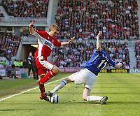 Photo: Andrew Unwin.<br />Middlesbrough v Everton. The Barclays Premiership. 29/04/2006.<br />Everton's James McFadden (R) looks to tackle Middlesbrough's James Morrison (L).