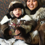 Qinugan Rexford and San Devin Tiegland pose in Inuit dress. Barrow, Alaska