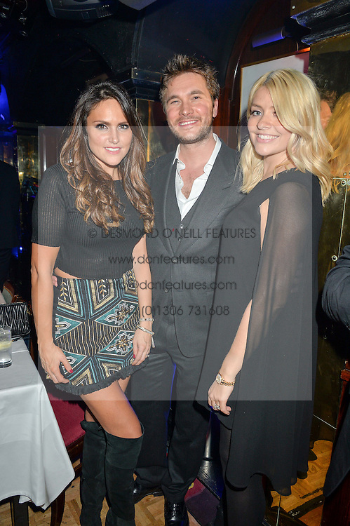 Left to right, BEN & ELLE CARING and HOLLY WILLOUGHBY at an exclusive performance by Mark Ronson at Annabel's, Berkeley Square, London on 2nd March 2016.