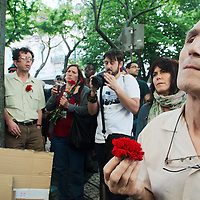 Man watching the speeches outside GNR quarters holding the always present carnation.
