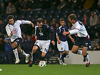 Photo: Andrew Unwin.<br />Scotland v USA. International Challenge. 12/11/2005.<br />Scotland's James McFadden (C) tries to get away from the USA's Benjamin Olsen (L) and James Conrad (R).