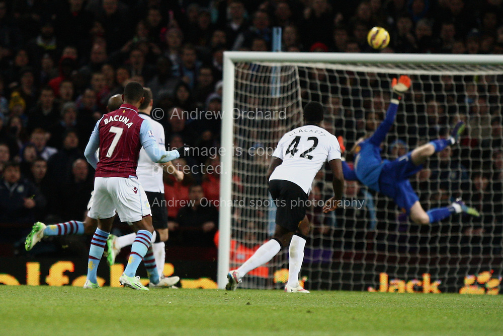 Leandro Bacuna of Aston Villa sees his shot fly narrowly over the crossbar. Barclays Premier league match, Aston Villa v Manchester Utd at Villa Park in Birmingham on Saturday 20th December 2014<br /> pic by Mark Hawkins, Andrew Orchard sports photography.