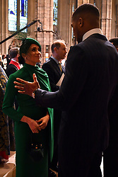 The Duchess of Sussex speaks with heavyweight boxer Anthony Joshua at the Commonwealth Service at Westminster Abbey, London on Commonwealth Day. The service is the Duke and Duchess of Sussex's final official engagement before they quit royal life.