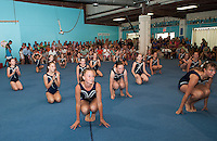"""Lakes Region Gymnastics """"Competition Team"""" does their routine for the packed open house Friday evening.  (Karen Bobotas/for the Laconia Daily Sun)"""