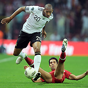 Turkey's Arda TURAN (R) and Germany's Jerome BOATENG (L) during their UEFA EURO 2012 Qualifying round Group A matchday 19 soccer match Turkey betwen Germany at TT Arena in Istanbul October 7, 2011. Photo by TURKPIX