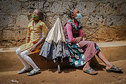 May 2, 2020, Nairobi, Kenya: 12 year old Martha Apisa (left) and her close neighbor 8 year old Stacy Ayuma (Right), are seen using their hair style braids to create awareness and sensation about the Corona Virus. (Credit Image: © Donwilson Odhiambo/ZUMA Wire)