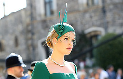 Lady Kitty Spencer arrives at St George's Chapel at Windsor Castle for the wedding of Meghan Markle and Prince Harry.