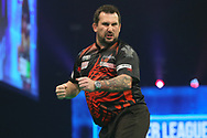 Jonny Clayton hits a 180 and celebrates during the PDC Unibet Premier League darts at Marshall Arena, Milton Keynes, United Kingdom on 27 May 2021.