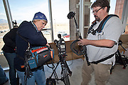 """04 FEBRUARY 2010 - CAMP VERDE, AZ:  Lisa Gage, left, and Brian Walker, freelancers on assignment for Good Morning America (Gage) and Inside Edition (Walker) check their sound gear before James Arthur Ray's initial appearance in the hallway of the Yavapai County Court for James Arthur Ray's initial appearance to start. Ray had his initial appearance in Yavapai County Court in Camp Verde Thursday morning. His bail was set at $5 Million Dollars (US). Ray did not post bail and remains in jail. Ray was arrested in Prescott, AZ, on Feb 3 and charged with three counts of manslaughter after three people died during a sweat lodge ceremony he was holding in Sedona, AZ, in October 2009. The ceremony was a part of a """"Spiritual Warrior"""" workshop Ray was leading. He charged participants $8,000 each. PHOTO BY JACK KURTZ    NO SALES"""