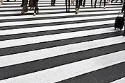 people walking on a zebra crossing Tokyo Japanpeople crossing at a zebra crossing Tokyo Japan