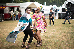© Licensed to London News Pictures . 12/08/2018. Manchester , UK . The second day of the annual Caribbean Carnival in Alexandra Park in Moss Side , celebrating music , food and Afro-Caribbean culture . A nearby shooting overnight lead to at least ten people injured . Ten people are in hospital . Photo credit : Joel Goodman/LNP