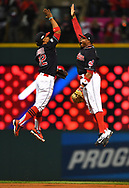 CLEVELAND, OH - OCTOBER 14: Francisco Lindor #12 and Rajai Davis #20 of the Cleveland Indians celebrate after defeating the Toronto Blue Jays in Game 1 of ALCS at Progressive Field on Friday, October 14, 2016 in Cleveland, Ohio. (Photo by Joe Sargent/MLB Photos via Getty Images)