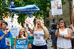 © Licensed to London News Pictures. 10/07/2017. London, UK. Pro-Charlie Gard supporters wait for Connie Yates and Chris Gard to leave The High Court in London on 10 July 2017. The parents of terminally ill Charlie Gard have returned to the High Court in light of new evidence relating to potential treatment for their son's condition. An earlier lengthy legal battle ruled that Charlie could not be taken to the US for experimental treatment. London, UK. Photo credit: Tolga Akmen/LNP