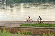 Friends age 15 bicycling along the Vistula River.  Torun Poland