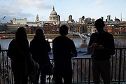 View of St Paul's from Tate Modern. Looking over the River Thames and Millennium Bridge towards the City of London, UK.