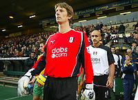 Fulham's Dutch goalkeeper Edwin Van Der Sar walks out at the start of the match with team mate Zesh Rehman