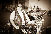 Biker with cigar on Harley Davidson motorcycle at Hooters bike night in south Oklahoma City