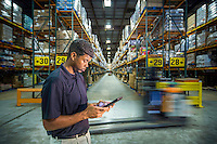 Associated Grocers manager Wilbur Fabre coordinates order selections at the companies distribution warehouse at 8600 Anselmo Lane in Baton Rouge, La.