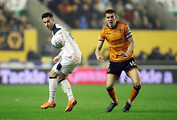 """Derby County's Tom Lawrence and Wolverhampton Wanderers' Conor Coady battle for the ball during the Sky Bet Championship match at Molineux, Wolverhampton. PRESS ASSOCIATION Photo. Picture date: Wednesday April 11, 2018. See PA story SOCCER Wolves. Photo credit should read: Nick Potts/PA Wire. RESTRICTIONS: EDITORIAL USE ONLY No use with unauthorised audio, video, data, fixture lists, club/league logos or """"live"""" services. Online in-match use limited to 75 images, no video emulation. No use in betting, games or single club/league/player publications."""