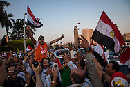 Anti government demonstrators celebrate what they see as a victory after the military arrested the president.