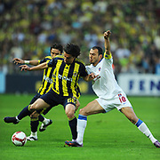 Fenerbahce's Mehmet TOPUZ (L) and Trabzonspor's Umut BULUT (R) during their Turkish superleague soccer derby match Fenerbahce between Trabzonspor at the Sukru Saracaoglu stadium in Istanbul Turkey on Sunday 16 May 2010. Photo by TURKPIX