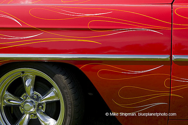 pinstripe flames on hot rod fender with front wheel