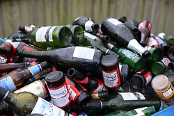 Empty bottles of alcohol lie in a recycling bin after the Christmas period at a centre near Ascot, Berkshire.