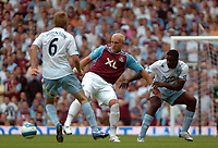 Photo: Tony Oudot. <br /> West Ham United v Manchester City. Barclays Premiership. 11/08/2007. <br /> Dean Ashton of West Ham holds the ball from Micah Richards and Michael Johnson of Manchester City