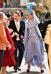 Poppy Delevingne arrives for the wedding of Princess Eugenie to Jack Brooksbank at St George's Chapel in Windsor Castle.