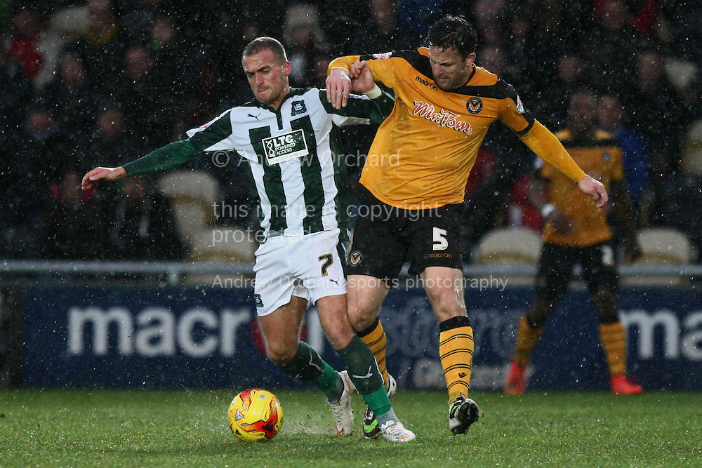 Lewis Alessandra of Plymouth Argyle (left) tussles for possession with Darren Jones of Newport County. Skybet football league two match, Newport County v Plymouth Argyle at Rodney Parade in Newport, South Wales on Boxing Day, Friday 26th December 2014<br /> pic by Mark Hawkins, Andrew Orchard sports photography.