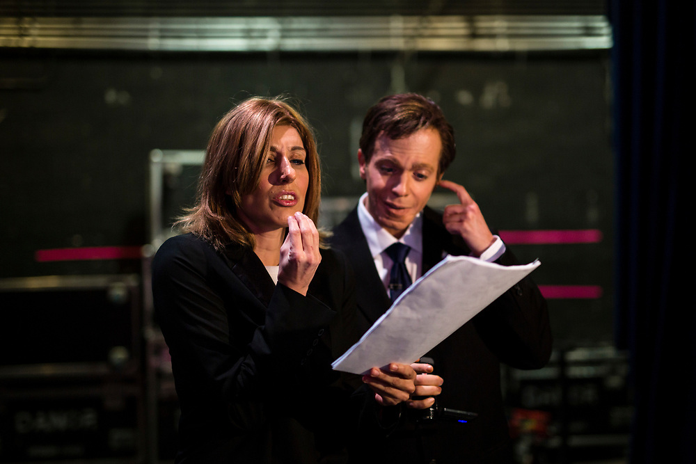 Israeli comic actors Roy Barnatan (R), who plays the role of Israeli Opposition Leader and leader of the Israeli Labor Party, Isaac Herzog Shany Cohen (L), who plays the role of former Israeli Justice Minister Tzipi Livni are seen as they rehearse their roles backstage prior to a filming of an episode of the top-rated Israeli satirical show 'Eretz Nehederet', Hebrew for 'Wonderful Country' at a television studio in Herzliya, Israel, on January 26, 2015.
