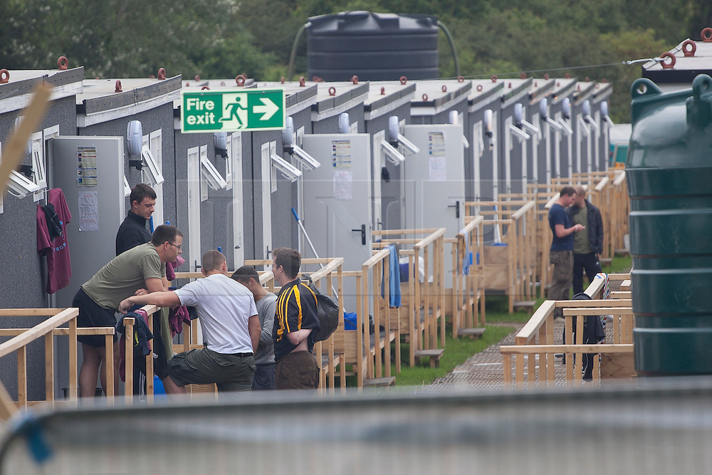© licensed to London News Pictures. London, UK 18/07/2012. Off-duty soldiers outside their accommodation containers in Hainault Country Park in Redbridge, east London. The base will accommodate 3,000 soldiers during the Olympics. Photo credit: Tolga Akmen/LNP