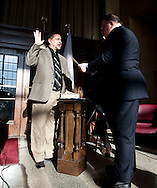 District 1 Council Member Kris Gulick (left) repeats the oath of office with Pat Kane (right), diaconal minister with Crossroads Mission, at the Cedar Rapids mayor and city council swearing in ceremony at the Veterans Memorial Building in Cedar Rapids on Saturday January 2, 2010. (Stephen Mally/Freelance)