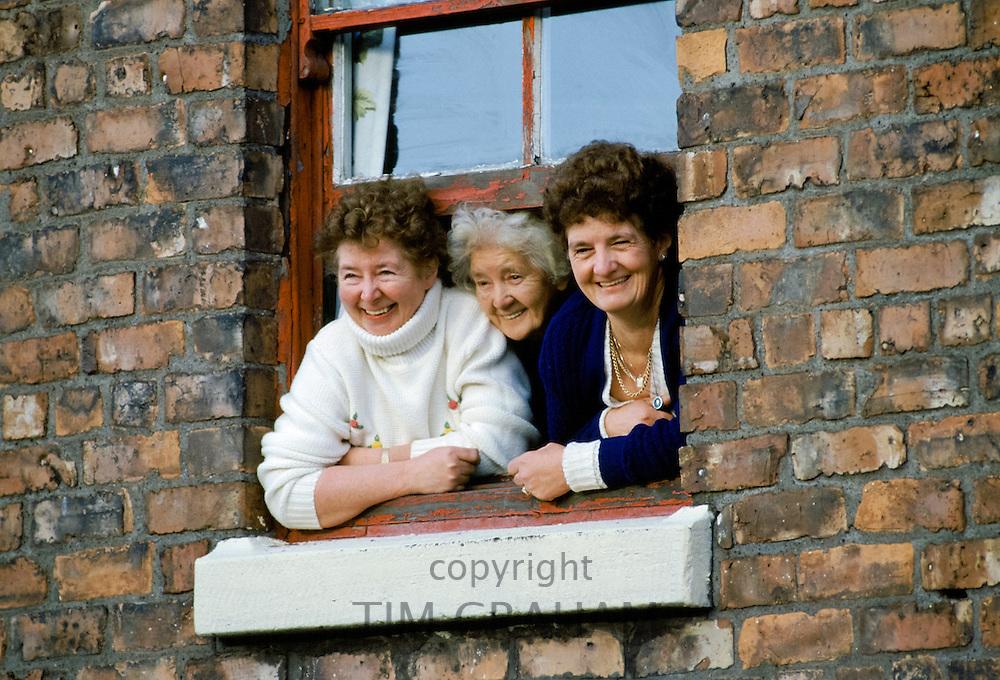 Women at a window, UK