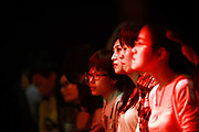 Young women watch a folk rock band performance at Mao Livehouse in Shanghai, China on Oct. 14, 2011.  Rock and roll remains a fringe genre of music in China, a country dominated by pop music, despite seeing a surge of popularity during the 80's and 90's.