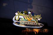 """Neon sign at Jimmy Buffett's """"Margaritaville"""" restaurant and bar. Waikiki, Honolulu, Hawaii"""